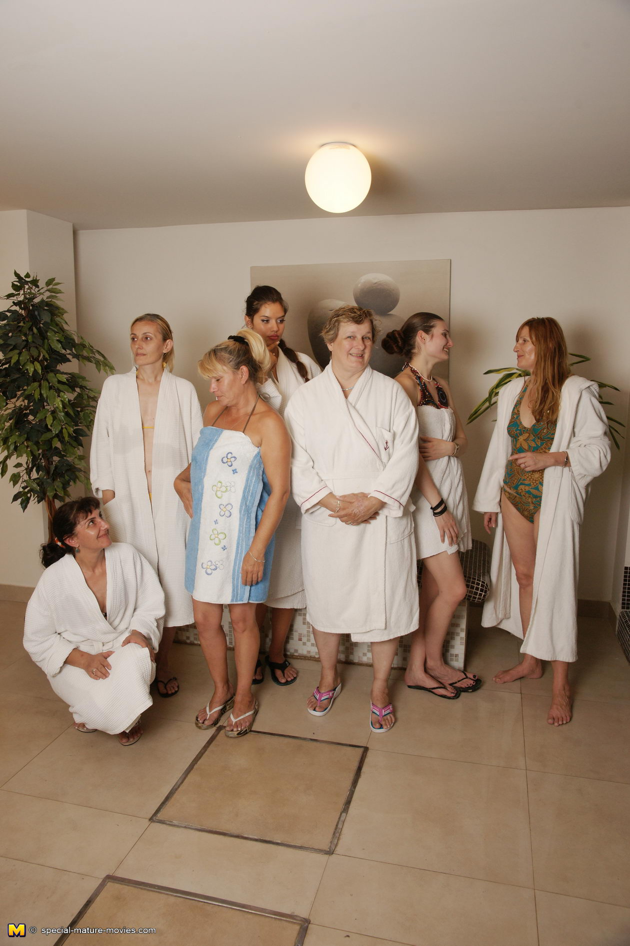 Aged matures relaxing in sauna